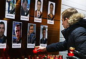 Moscow, Russia. 25th Dec, 2016. Photographs of Channel One, NTV and Zvezda TV channels journalists killed in a Russian Defense Ministry plane crash outside the Ostankino Technical Center. A Tupolev Tu-154 plane of the Russian Defense Ministry with 92 people on board crashed into the Black Sea near the city of Sochi on December 25, 2016. The plane was carrying members of the Alexandrov Ensemble, Russian servicemen and journalists to Russia's Hmeymim air base in Syria. Fragments of the plane were found about 1.5km from Sochi coastline. Artyom Geodakyan/TASS - Stock Image - HF081C