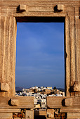 The Portara (temple of Apollo) and the Chora ('capital') of Naxos island in the background. Cyclades, Greece - Stock Image - CPK2TT