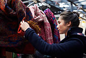 Young Woman Shopping In Covered Market - Stock Image - FWWC4F