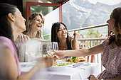 Women eating together in restaurant - Stock Image - E6RGDC