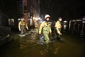 Luebeck, Germany. 04th Jan, 2017. Members of a local fire brigade in Luebeck, Germany, 04 January 2017. The Federal Maritime and Hydrographic Agency (BSH) forecast storm tides along the German Baltic coast with water levels rising to 1.5 meters above average. Photo: Bodo Marks/dpa/Alamy Live News - Stock Image - HG6EHG