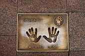 Film stars bronze hand prints in Leicester Square, London, UK - Stock Image - B9B3RJ