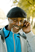 Senior man using a mobile phone, Sweden. - Stock Image - BHH4JN