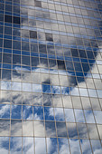 Reflection of sky in windows of office building - Stock Image - BK7EM0