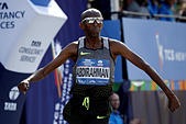 Abdi Abdirahman of the U.S. crosses the finish line to finish third in the men's field of the 2016 New York City Marathon in Central Park in the Manhattan borough of New York City, NY, U.S. November 6, 2016. REUTERS/Mike Segar - Stock Image - H9TX8T