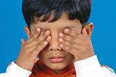 small young boy with both hands on eyes   MR#152 - Stock Image - CE6DNA