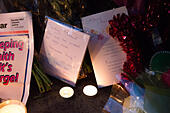 Goring, UK. 26th Dec, 21016.  Flowers, candles and words of sympathy were left outside George Michael's home in Goring. George Michael passed away yesterday.© Pete Lusabia/Alamy Live News - Stock Image - HF0C93