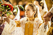Valencia, Spain. March 18th, 2014: A little Fallera finally offers her flower bouquet to the Virgin and hands it over to be placed at the virgins image. © matthi/Alamy Live News - Stock Image - DX68R6