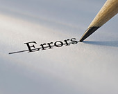 Studio shot of pencil crossing out the word errors from piece of paper - Stock Image - C3HK68