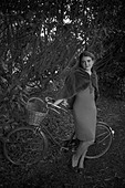 Girl with a bicycle in a vintage 1940 style - Stock Image - BPBW1E