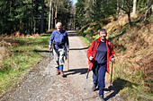 Active elderly people go hill walking in the Trossachs National Park, Scotland - Stock Image - BKW476