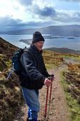 Active elderly people go hill walking in the Trossachs National Park, Scotland - Stock Image - BKWAFM