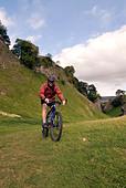 Doug Blane mountain biking Cavedale Castleton in the Peak District National Park Derbyshire UK England GB Great Britain - Stock Image - B55PGN