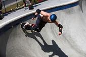 Skateboarder doing tricks Culver City Skateboard Park Culver City Los Angeles County California United States of America - Stock Image - BAFN80
