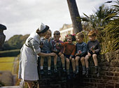 A nurse with child evacuees from Plymouth in the garden of the Chaim Weizmann Home at Tapley Park, Instow, North Devon, October - Stock Image - D8NWFG