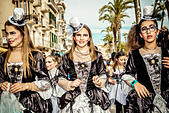 Sitges, Spain. March 4th, 2014: Girls in fantasy costumes dance during the the children carnival parade in Sitges. © Matthias Oesterle/Alamy Live News - Stock Image - DWCNBG