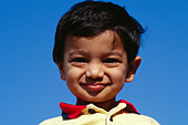 smart young small indian boy against blue sky india MR#152 - Stock Image - CE6DR7