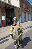 Female firefighter in rural volunteer fire department working with equipment. - Stock Image - EXHT2F