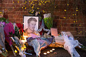 Goring, UK. 26th Dec, 21016.  Flowers, candles and words of sympathy were left outside George Michael's home in Goring. George Michael passed away yesterday.© Pete Lusabia/Alamy Live News - Stock Image - HF0C8M