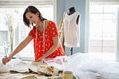 Female seamstress working in home studio - Stock Image - D7JGKP