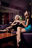 Two pretty girl having fun together - Stock Image - C690AM