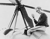 Amelia Earhart (1897-1937), waving, seated outside cockpit on top of an Autogiro, in Los Angeles, shortly after she became the - Stock Image - CWBRD5