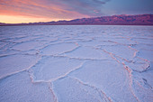 Sunrise over salt polygons and patterns at Badwater Salt Flats in Death Valley National Park, California, USA - Stock Image - CEACJ2