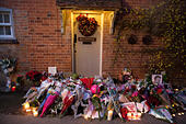 Goring, UK. 26th Dec, 21016.  Flowers, candles and words of sympathy were left outside George Michael's home in Goring. George Michael passed away yesterday.© Pete Lusabia/Alamy Live News - Stock Image - HF0C8G