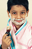 small young boy pretending acting to shave   MR#152 - Stock Image - CE6DP9