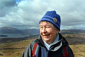 Active elderly people go hill walking in the Trossachs National Park, Scotland - Stock Image - BKWBDG