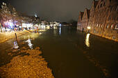 Luebeck, Germany. 04th Jan, 2017. A flooded street in Luebeck, Germany, 04 January 2017. The Federal Maritime and Hydrographic Agency (BSH) forecast storm tides along the German Baltic coast with water levels rising to 1.5 meters above average. Photo: Bodo Marks/dpa/Alamy Live News - Stock Image - HG6EJ0