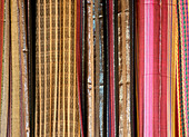 rolls of fabric for sale background texture - Stock Image - D7KY72