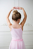 Young girl performing a ballet move - Stock Image - B07WH6