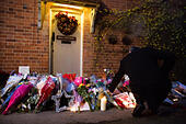 Goring, UK. 26th Dec, 21016.  Flowers, candles and words of sympathy were left outside George Michael's home in Goring. George Michael passed away yesterday.© Pete Lusabia/Alamy Live News - Stock Image - HF0C8Y