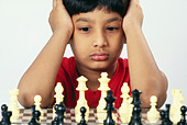 small young boy playing chess   MR#152 - Stock Image - CE6DP8