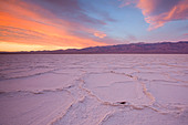 Sunrise over salt polygons and patterns at Badwater Salt Flats in Death Valley National Park, California, USA - Stock Image - CEACMP