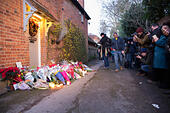 Goring, UK. 26th Dec, 21016.  Flowers, candles and words of sympathy were left outside George Michael's home in Goring. George Michael passed away yesterday.© Pete Lusabia/Alamy Live News - Stock Image - HF0C8H