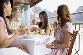 Women eating together in restaurant - Stock Image - E6RGDA