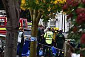 London, United Kingdom. 31st October 2017. A man has been rescued from a house fire in Leythe Road in Acton, London. The man received medical attention by the roadside before being transported to a London hospital. Credit: Peter Manning/Alamy Live News - Stock Image - KFPNJ0