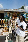 Jamaica Negril beach cool Rastafari man with souvenir shop - Stock Image - AYG7EK