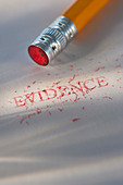 Studio shot of pencil erasing the word evidence from piece of paper - Stock Image - C3HK7N