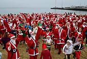 Weymouth Beach in Dorset, UK. 18th Dec, 2016. Chase the Pudding Santa Run on Weymouth Beach in Dorset, UK Credit: Dorset Media Service/Alamy Live News - Stock Image - HE61B4