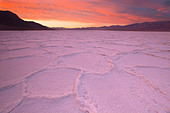Sunrise over salt polygons and patterns at Badwater Salt Flats in Death Valley National Park, California, USA - Stock Image - CEACK7