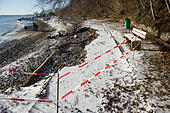Sassnitz, Germany. 06th Jan, 2017. A collapsed path in Sassnitz, Germany, 06 January 2017. The aftermath of the storm has drawn droves of visitors curious to inspect the damage to the area. The head of the local district authority Drescher (CDU) warned visitors and locals not to walk too close to the edges of cliffs. Photo: Stefan Sauer/dpa-Zentralbild/dpa/Alamy Live News - Stock Image - HGAEPE