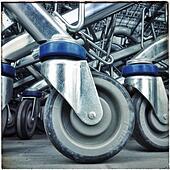 Supermarket shopping cart trolley wheels - Stock Image - S039ET