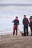 Netherlands, Scheveningen. Bicentenary celebrations. Historic landing at Scheveningen beach. Fishermen in traditional costume - Stock Image - DMNX6P