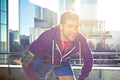 athlete with earphones running in the city - Stock Image - H7MH9Y