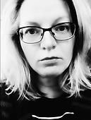 Headshot of a woman with glasses - Stock Image - S1CJ7P