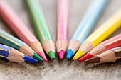Macro closeup of colorful wooden color pencils on rustic background and selective focus and copy space - back to school concept - Stock Image - DBJA5B