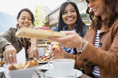 Women eating together in cafe - Stock Image - E6RGC3